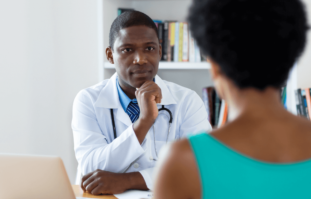A medical provider conversing with a patient